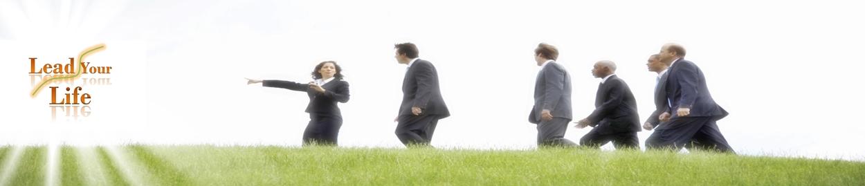 Businesswomen leading businessmen outdoors
